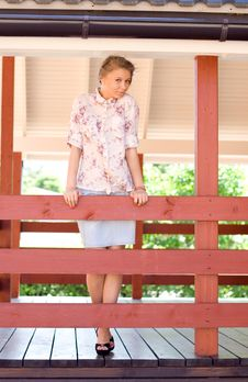 Girl On A Veranda Stock Images