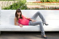 Free Girl Sitting On Bench Royalty Free Stock Image - 15074516