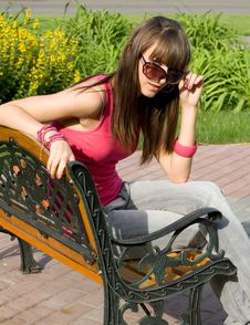 Free Girl Sitting On Bench Royalty Free Stock Photography - 15074747