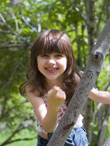 Free Happy Young Girl Points A Finger Stock Image - 15075041