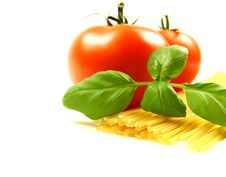 Tomato With Pasta And Basil Leafs Royalty Free Stock Photos