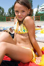 Free Little Girl Sunbathing At The Beach Stock Photos - 15082813