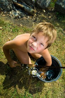 Free Boy With A Bucket And A Fishing Rod Stock Photo - 15082430