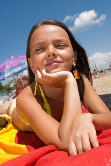 Free Little Girl Sunbathing At The Beach Stock Image - 15082851