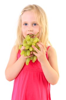 Little Baby Girl Eats The Big Grapes Royalty Free Stock Photography