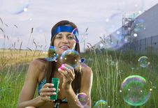 Free Woman Blows Soap Bubbles Royalty Free Stock Photo - 15083745