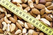 Free Assorted Nuts With Measure Tape Stock Photos - 15084323