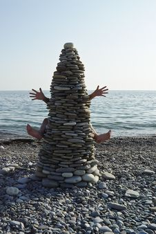 Free Stone Tower With Hands And Legs On The Beach Royalty Free Stock Image - 15087896