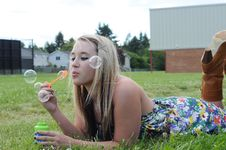 Free Girl Blowing Bubbles In Grass Stock Photo - 15089280