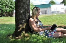 Girl Reading Book Under Tree Royalty Free Stock Photography