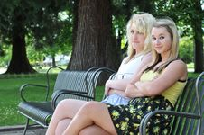 Free Two Girl Friends Sitting On A Bench Stock Photos - 15089413