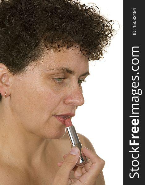 Woman uses lipstick