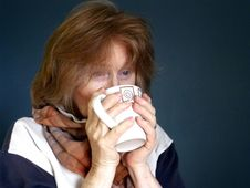 Free Adult Female With Warming Mug Of Hot Drink Stock Photos - 15092003