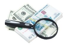 Dollars And Roubles And Magnifying Glass Stock Photography
