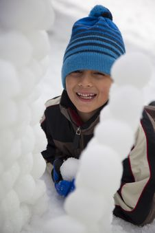 Free Young Boy Behind Snowball Wall Royalty Free Stock Image - 15092766