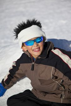 Young Boy With Fun Beanie On Snow Stock Image