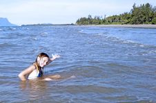 The Girl Learns To Swimm In The Sea. Royalty Free Stock Photos