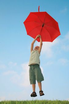 6 Years Boy Flying With Umbrella Stock Image