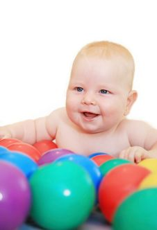 Baby With Balls Royalty Free Stock Photos