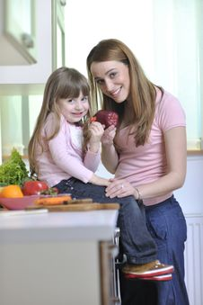 Free Happy Daughter And Mom In Kitchen Royalty Free Stock Photo - 15099155