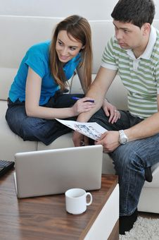 Free Young Couple Working On Laptop At Home Royalty Free Stock Images - 15099179
