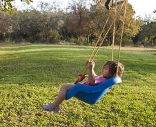 Free Young Girl Swinging Stock Images - 15099494