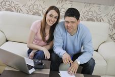 Young Couple Working On Laptop At Home Stock Image
