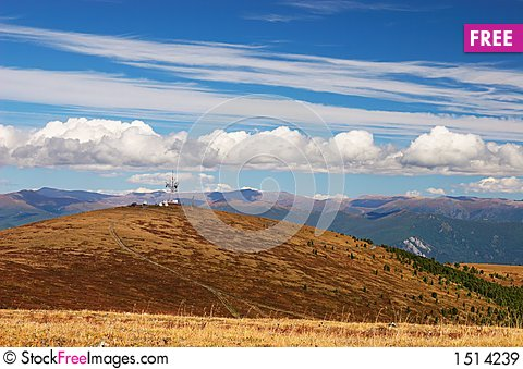 Blue sky, clouds and mountains. Stock Photo