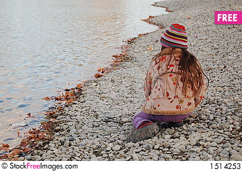 Child on the beach, autumn Stock Photo