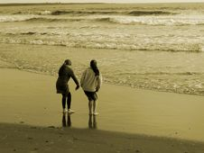 Two Girls Playing On The Beach Royalty Free Stock Photo