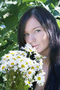 Free A Girl Gets On The Hip The Bouquet Of Camomiles Royalty Free Stock Image - 15106956