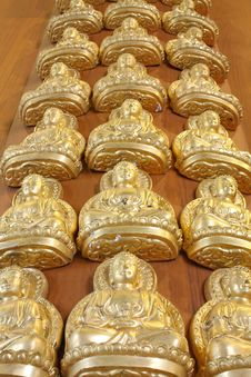 Free Pattern Of Gold Buddha Doll Royalty Free Stock Image - 15101966