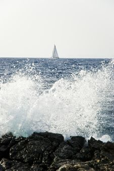 Free Crashing Wave And Sailing Boat Royalty Free Stock Photos - 15102078