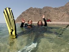 Free Female Scuba Diver Swimms Backwards On Surface Stock Image - 15106521