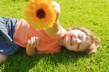 Little Girl Resting On Meadow Stock Photography
