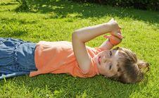 Little Girl Resting In The Garden Grass Stock Photography