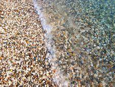 Bright Pebble Beach And Water, Crimea, Ukraine Stock Photos
