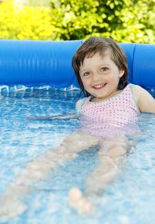 Little Girl Swimming In Basin Stock Photo