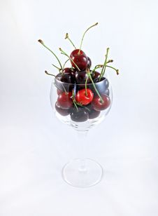 Fresh Ripe Cherries In A Wine Glass Stock Image