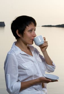 Free Young Woman Meets Sunrise Drinking Morning Coffee Stock Image - 15117001