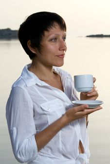 Free Young Woman Meets Sunrise Drinking Morning Coffee Stock Photography - 15117022