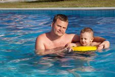 Daddy Learns The Son To Swim Stock Photos
