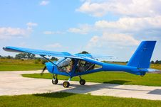 Small Blue Airplane Under Sky Stock Photos