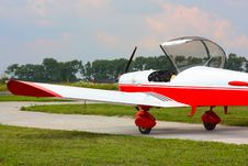 Small Red Airplane Under Sky Stock Photo