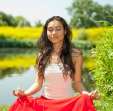 Free Young Woman Sitting In Park Stock Photo - 15117900