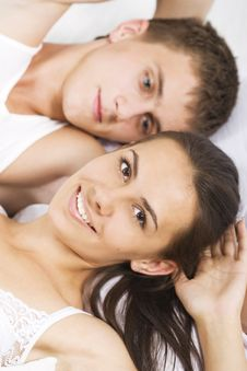 Young Couple In A Bed Stock Photos