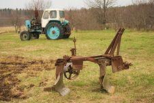 Old Plow And Tractor Stock Images
