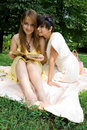 Free Young Girls Sitting On Coverlet Upon Green Grass Royalty Free Stock Photos - 15139868