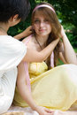 Free Girl Braiding Her Friends Hair Outdoors Stock Images - 15139944