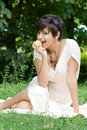 Free Healthy Young Girl Eating An Apple Outdoors Royalty Free Stock Images - 15139989